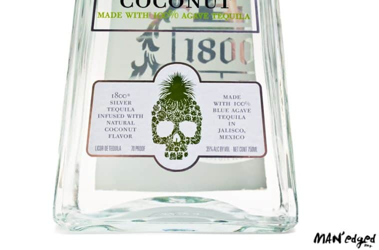 Close up 1800 Tequila bottle featuring the alcohol's festive skull design.
