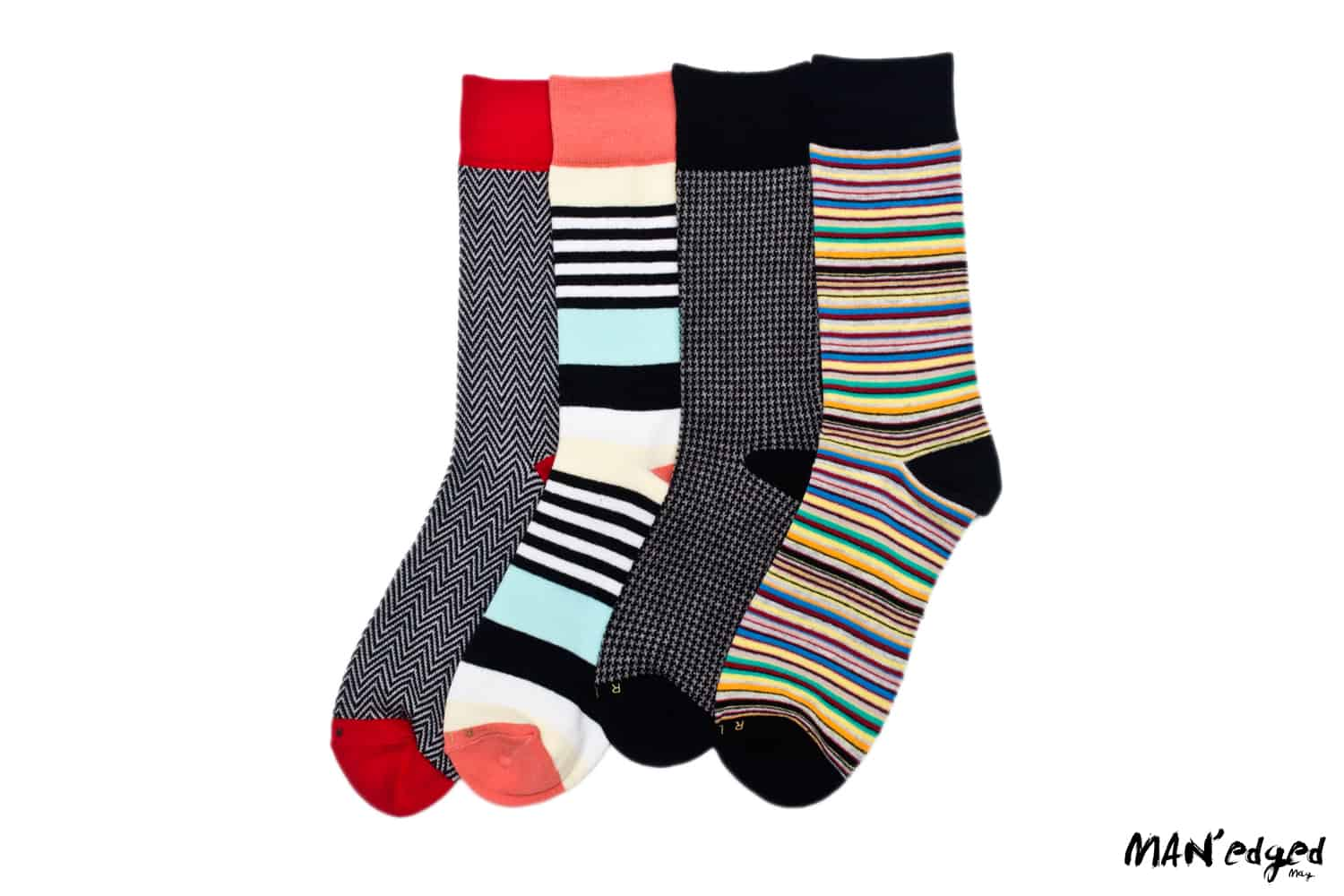 large image of related garment socks, featuring bold men's sock designs and colors