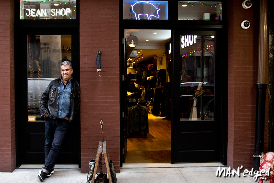 Eric Goldstein standing in front of Jean Shop SOHO location New York City