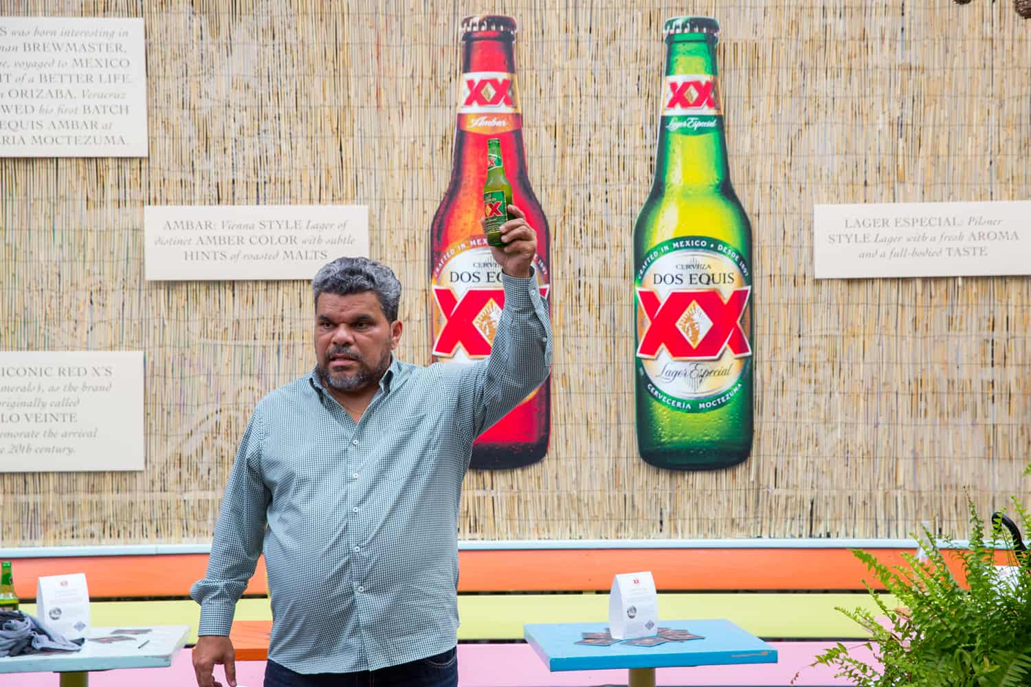 Does Equis spokesman Luis Guzman holding beer in Most Interesting Person Index