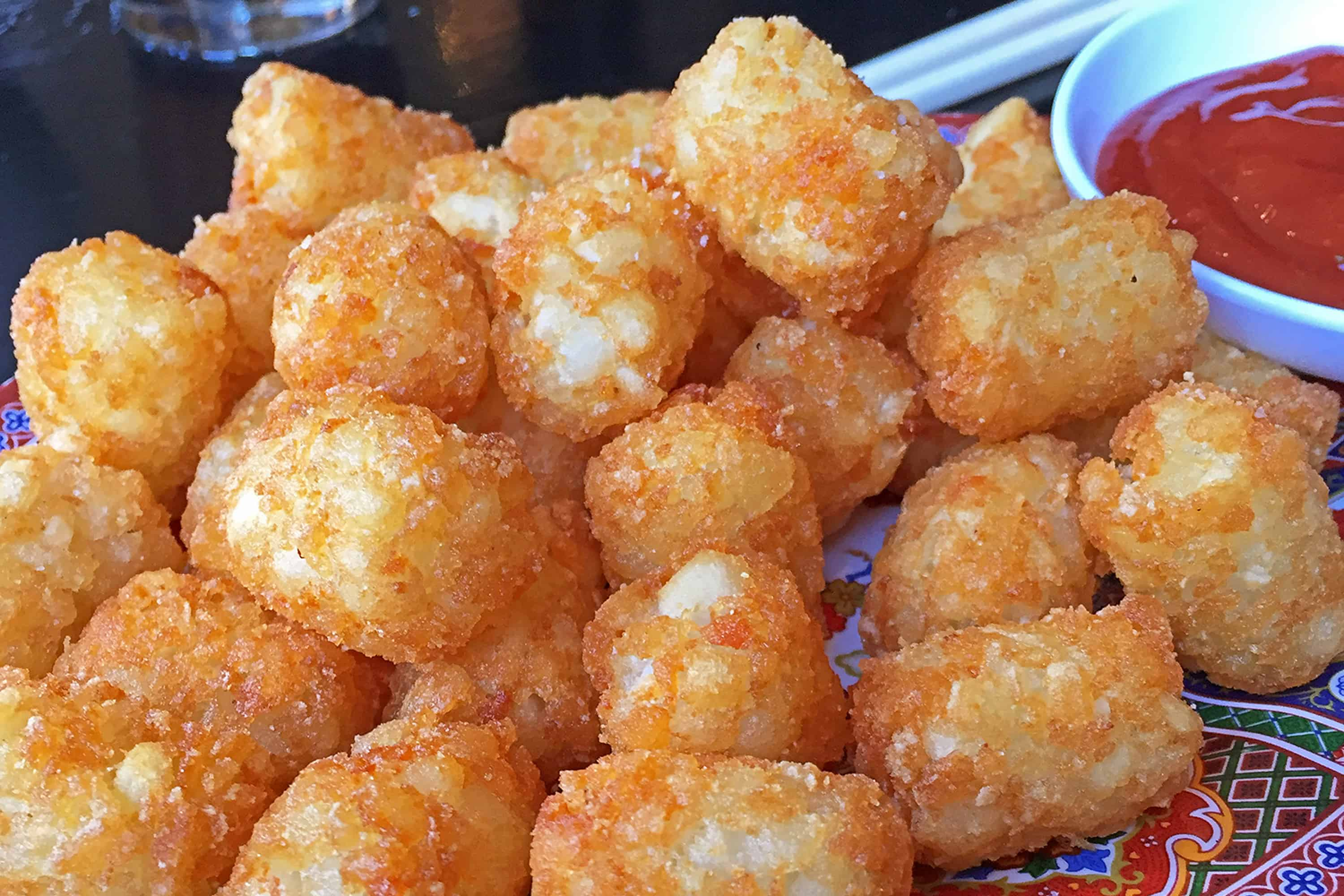 Tator tots and spicy ketchup from Talde Brooklyn in MAN'edged Magazine best foods to celebrate 420