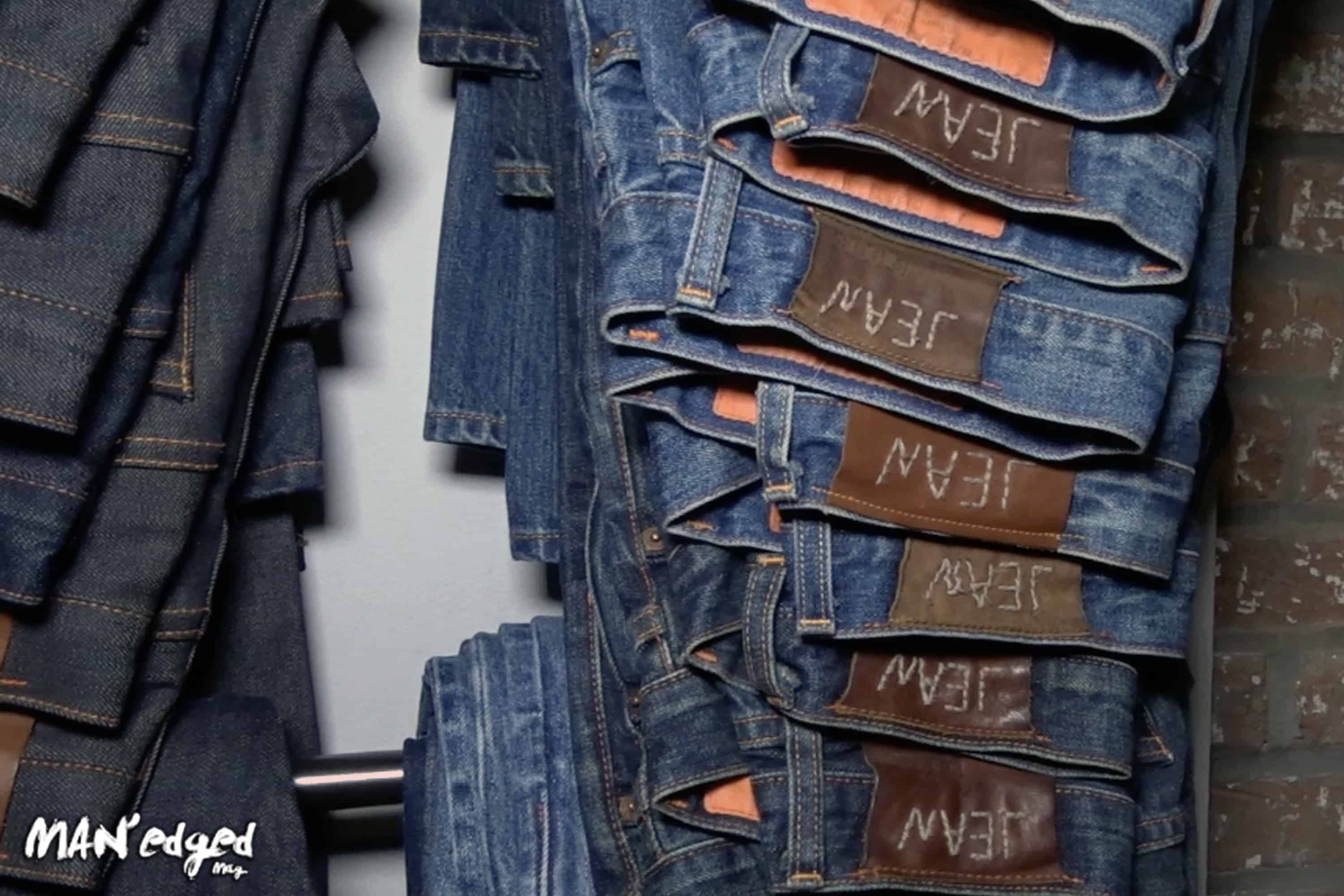 Men's Denim pants hanging on wall