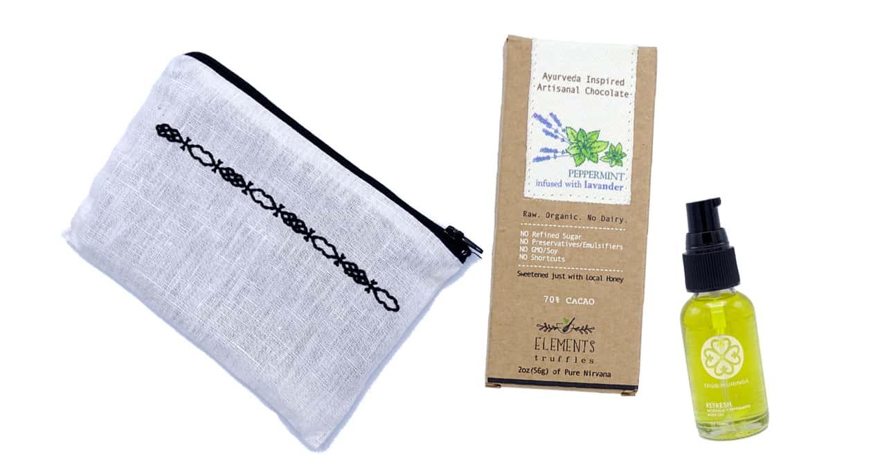 Artisanl Beauty box by True Morninga. Left silk pouch, center chocolate bar, right all purpose oil