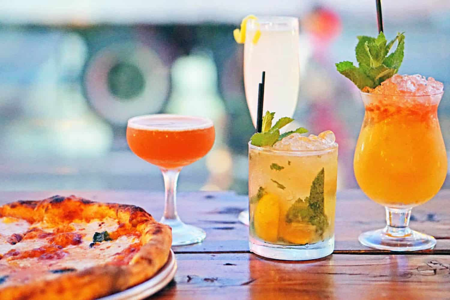 Pizza from Wheater restaurant with various cocktails