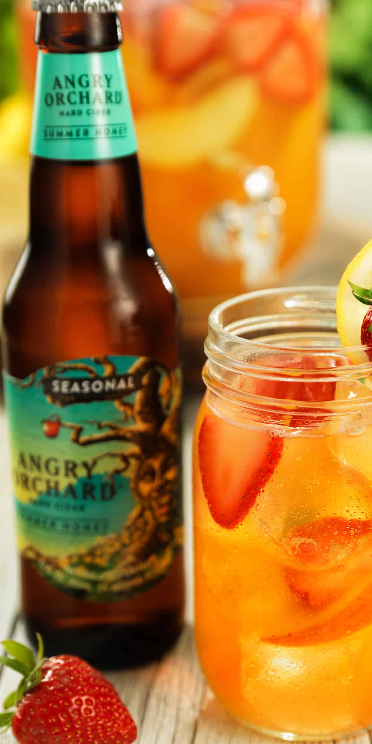 Angry Orchard beer bottle and party punch cocktail for guys