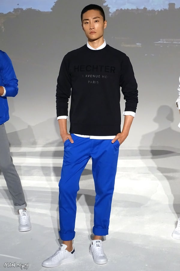 Male models posing at Men's Day Dune Studios in Daniel Hechter wearing black sweater and blue pants MAN'edged Magazine