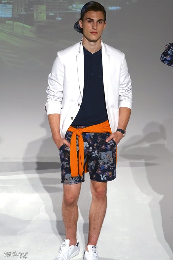 Male models posing at Men's Day Dune Studios in Daniel Hechter wearing white sports coat and shorts MAN'edged Magazine