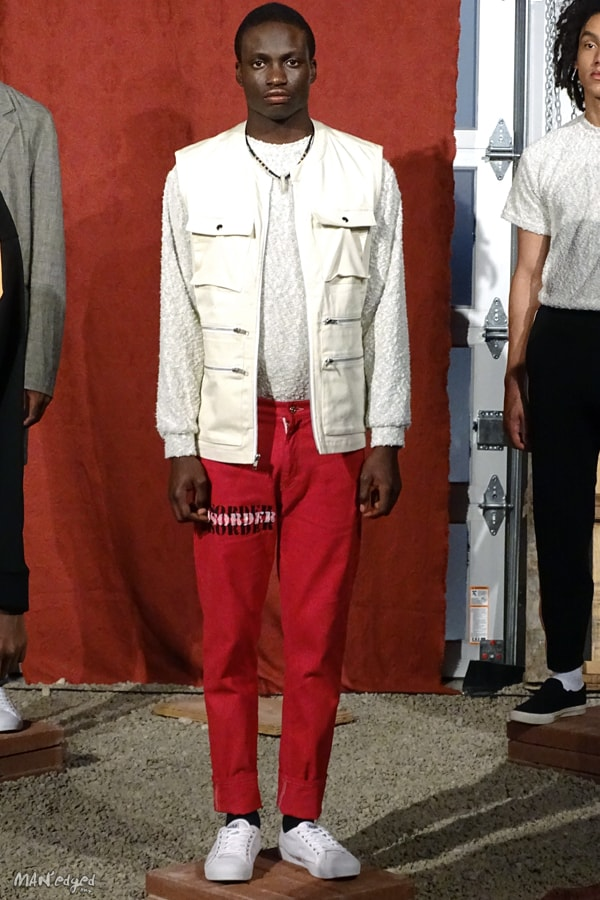 Male models posing at Men's Day Dune Studios in Head of State wearing white vest, shirt, and red pants MAN'edged Magazine