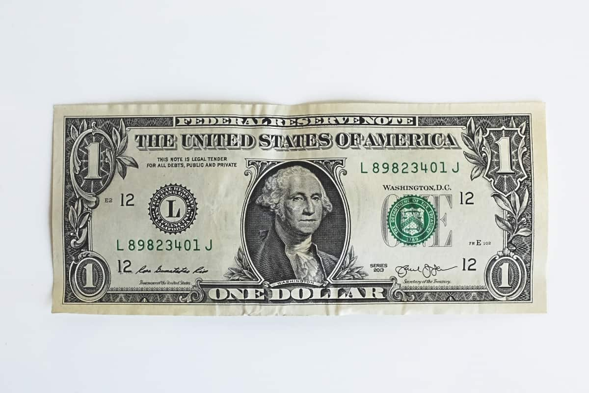 a dollar bill that symbolizes how much men's skincare should cost