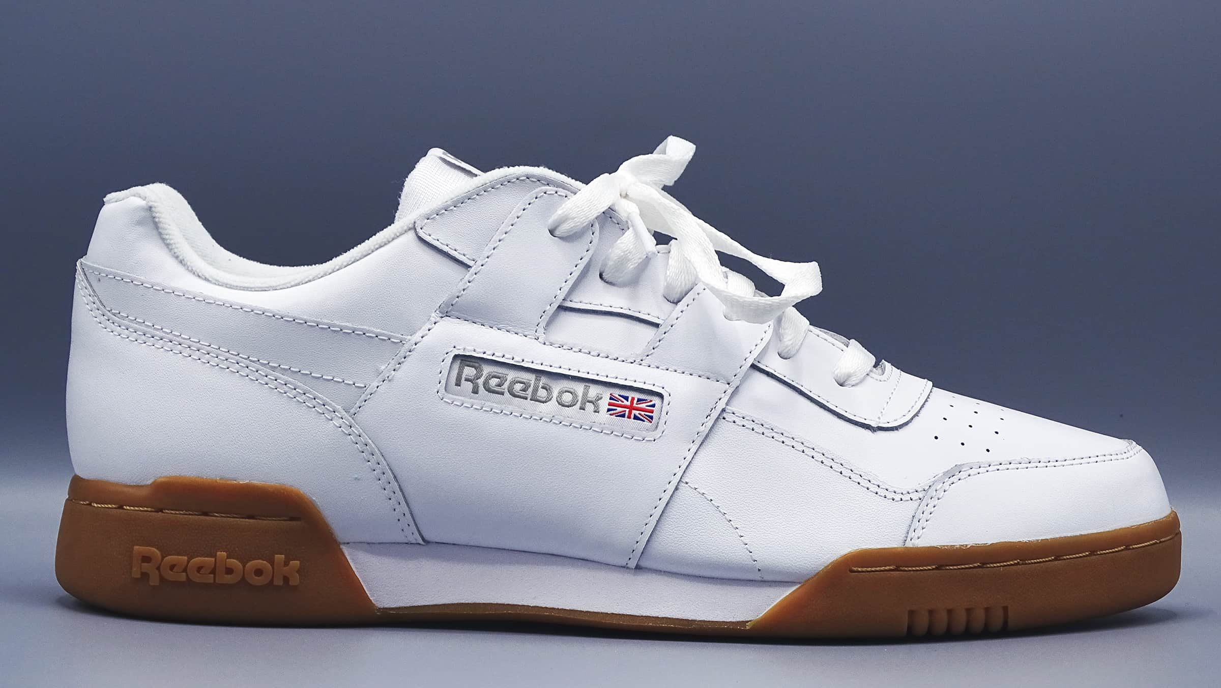 White men's reebok sneaker with gum colored bottom