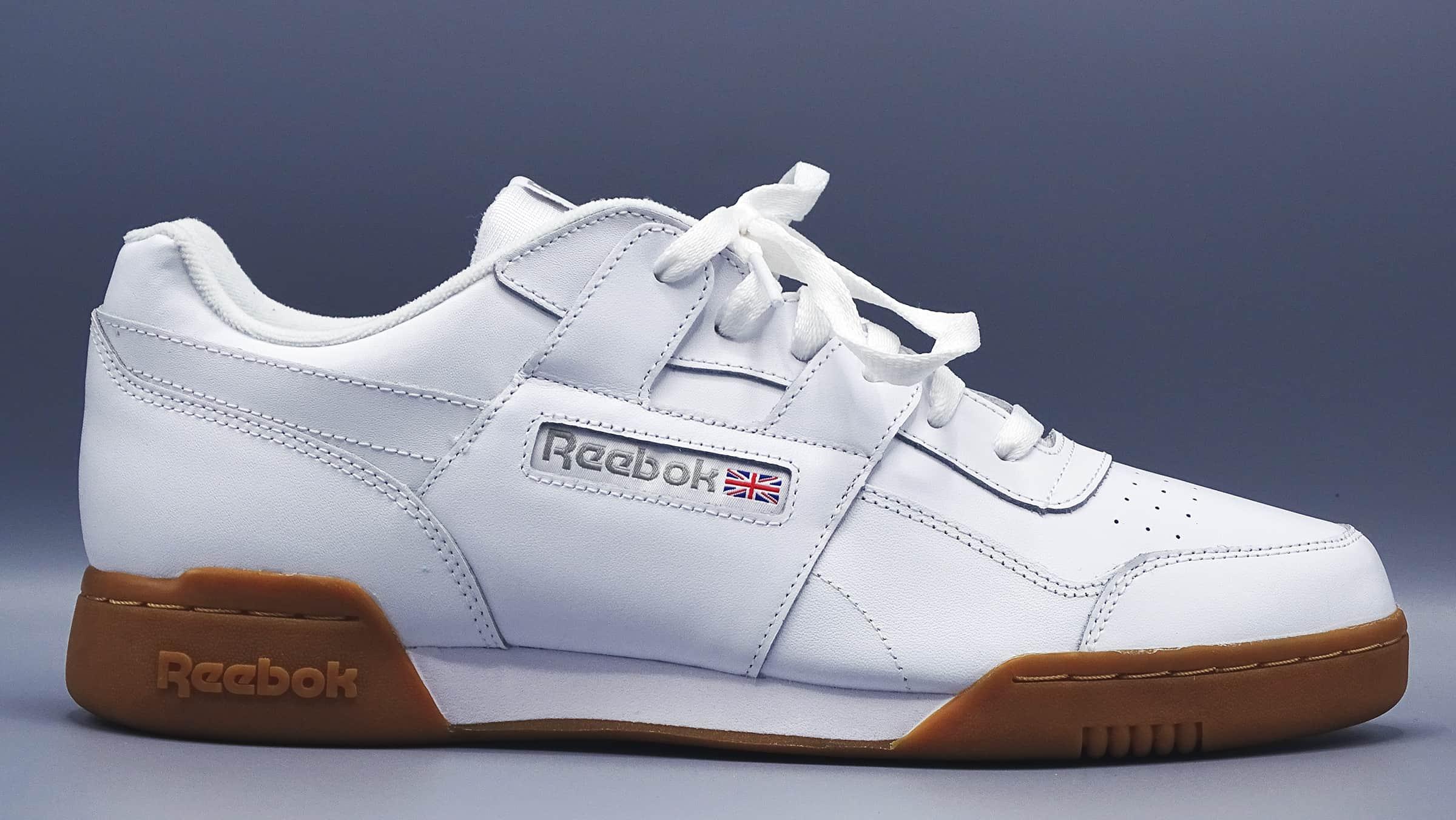 White men's reebok sneaker with gum colored bottom
