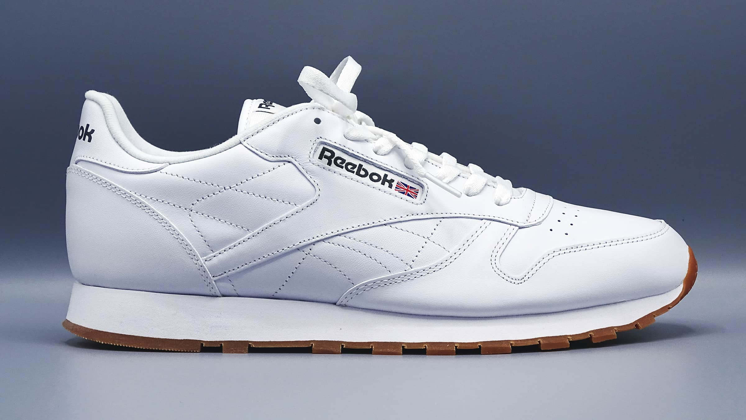 White reebok men's classic sneaker with gum colored bottom
