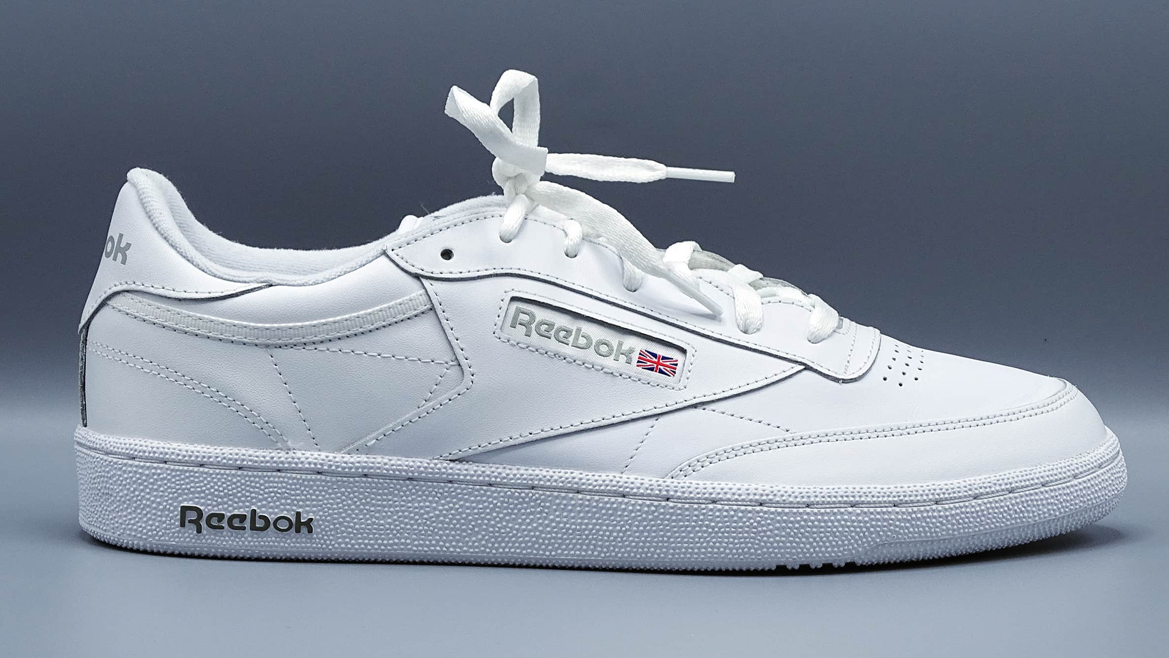 Men's sleek profile all white reebok sneaker