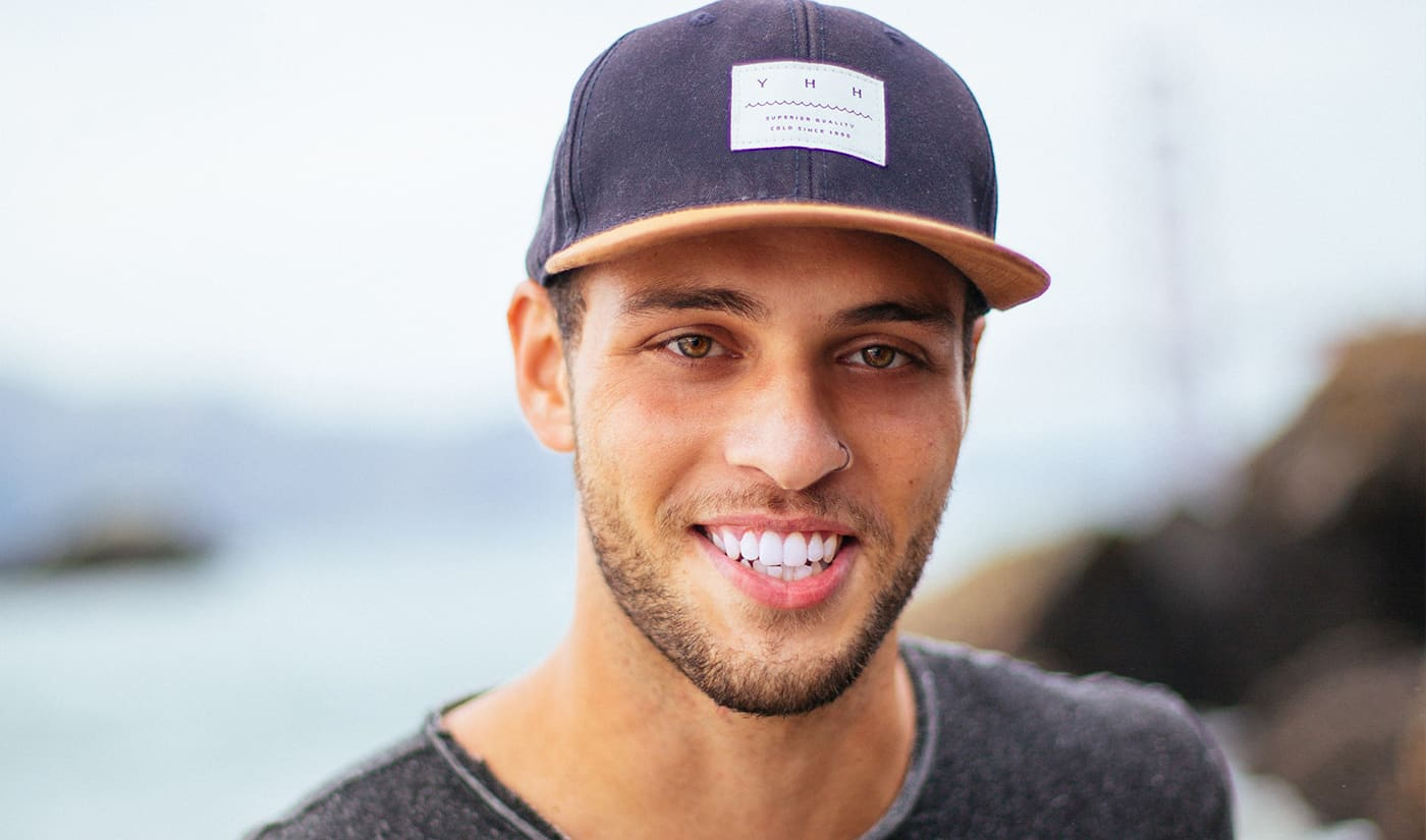 Young guy with cap smiling