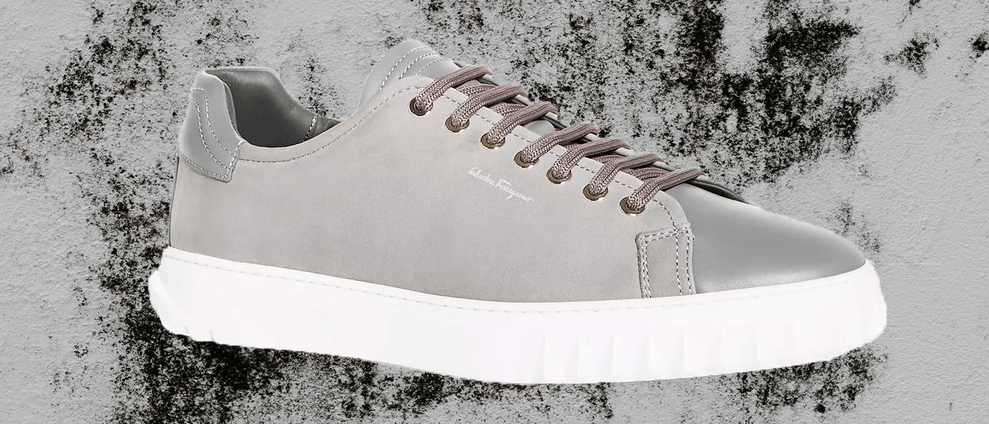 Gray Salvatore Ferragamo Leather Low-Top sneakers with dark gray shoe laces.