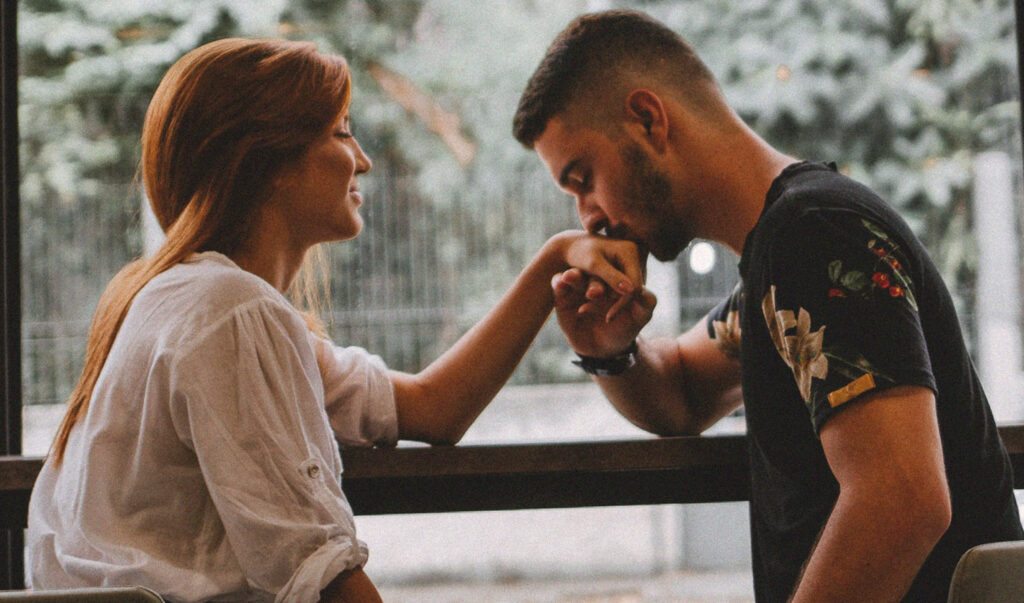 10 best dating tips for guys photo featuring a man kissing a woman's hand on first date