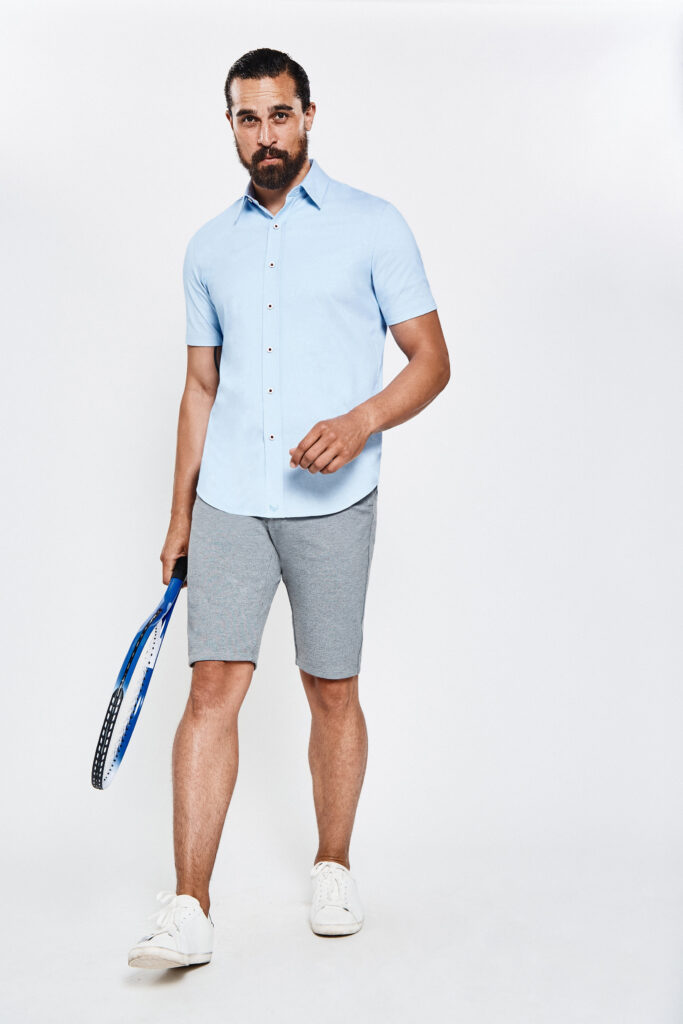 man holding tennis racket wearing the new icy shirt by buttercloth